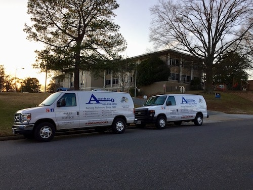 Two Locksmith Trucks parked in front of a sunset. We are a Locksmith Glen Allen VA.