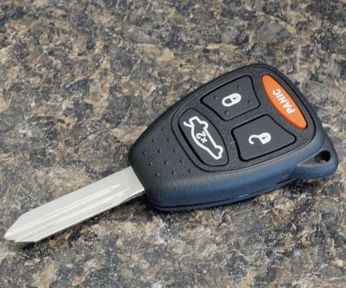 car key fob and remote sitting on a desk