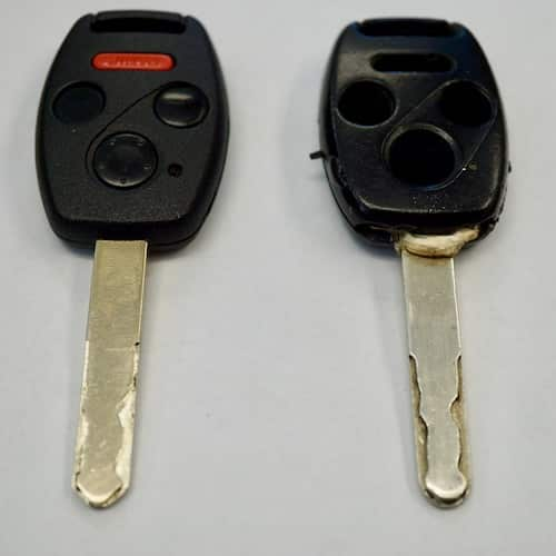 Two High Security Laser Car Keys Side By Side; one new, one old.